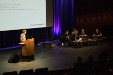 """Picture of Kristoffer Gansing (left) introducing the panel """"An Ecosystem of Excess"""""""
