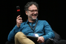 """Jonathan Beller at the panel """"Confronting Social Cybernetics"""" at transmediale 2018 face value."""