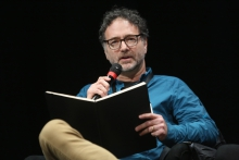 """Jonathan Beller during the panel """"Confronting Social Cybernetics"""" at transmediale 2018 face value."""