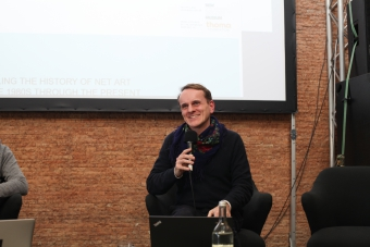 """Dragan Espenschied during the panel """"Growing a Repertoire: The Preservation of Net Art as Resistance to Digital Industrialism"""" at transmediale 2018 face value."""