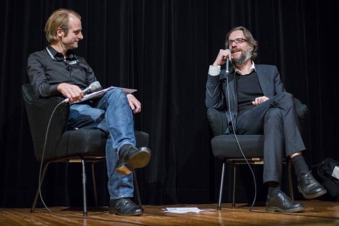 """Picture of Florian Wüst (left) in conversation with Thibaut de Ruyter (right) after the screening of """"Echtzeit"""""""