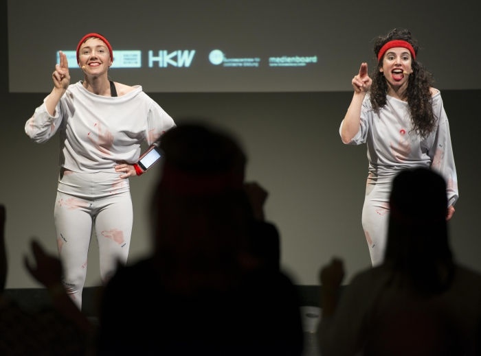 """Picture of Phoebe Osborne (left) and Liat Berdugo (right) at the workshop """"Unpatentable Multi-touch Aerobics"""""""