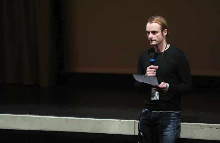 """Florian Wüst introducing the screening """"redux/time/OUT OF JOINT"""" at transmediale 2017."""