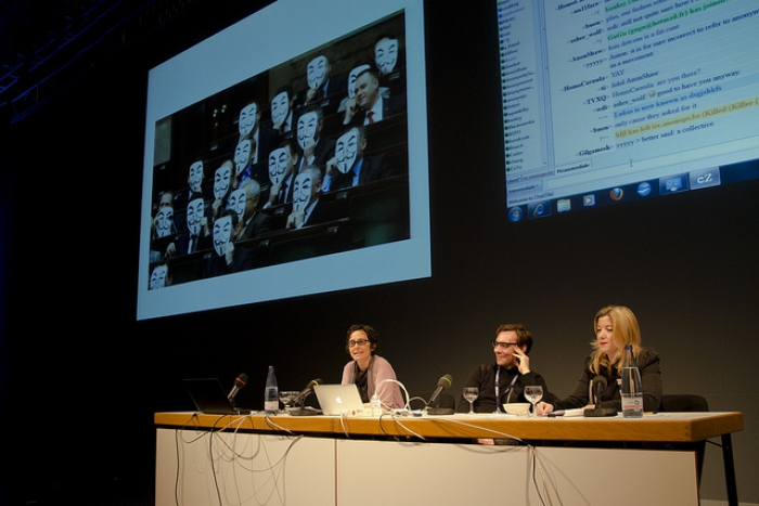 """Gabriella Coleman, Jacob Appelbaum and Tatiana Bazzichelli at """"Anonymous Codes: Disruption, Virality and the Lulz"""", transmediale 2012 in/compatible."""