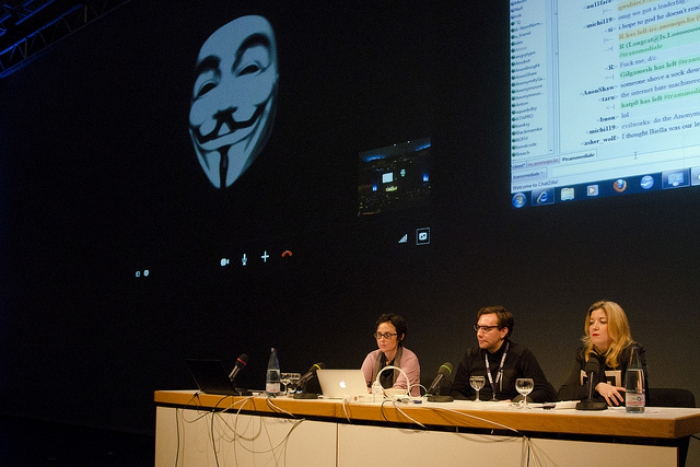 "Gabriella Coleman, Jacob Appelbaum and Tatiana Bazzichelli (left to right) at ""Anonymous Codes: Disruption, Virality and the Lulz"", transmediale 2012 in/compatible."